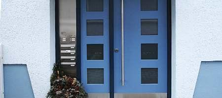 Blue wood front door with lateral element