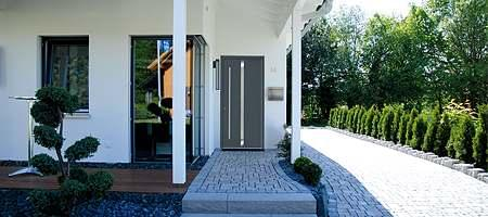 Roofed entrance area with grey front door