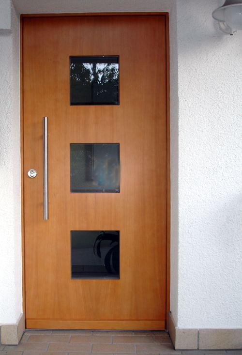 Wooden front door with square glass inset