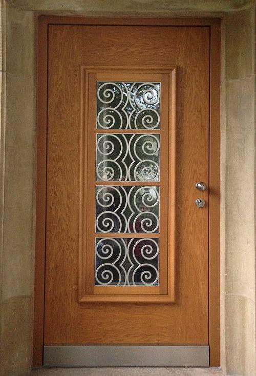 Wooden front door with ornamental glazing