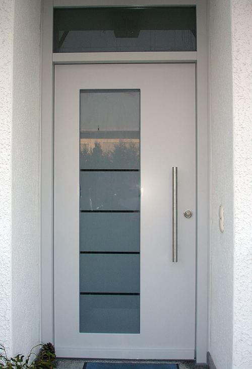 Wooden front door with satinated glass inset