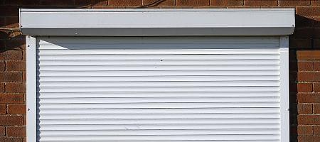 Front-mounted roller shutters